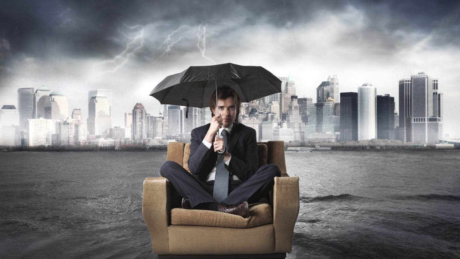 businessman_chair_flood_umbrella_river_storm_city_79817_1600x900